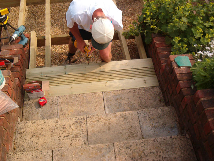 Fitting pre-treated decking boards - Allow shrinkage, stagger joints