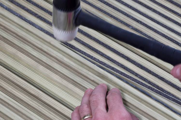 Fitting Q-Grip decking insert strips