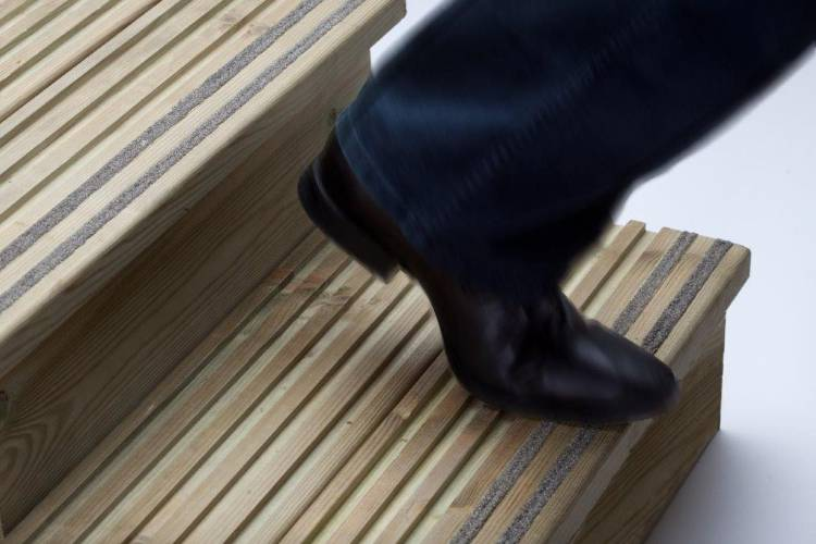 Q-Grip decking insert strips in deck